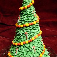 Christmas Tree Cake This is an almond apricot cake, with almond buttercream and marzipan filling. The branches/needles are buttercream and the decorations are...