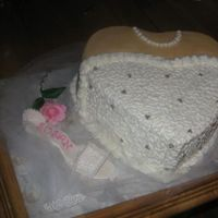2Nd Wedding Shower Cake The Gumpaste shoes were my 1st. Alot easier said than done. I'll get it better next time.