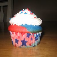 4Th July Cupcake WASC with twinkie filling and Almond icing. Did half and half color with white filling.When you bit into it then, it was red white and blue...