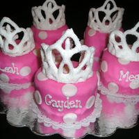 "Mini Princess Cakes   These were for a little girls birthday party. Tiara's are made with RI. Cakes are double layer bout 4"" tall covered in MMF."
