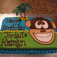 Monkey Cake  This cake was for 2 of my children's Birthday's. The cake is frosted in BC. The bananas are Runts candy and the palm tree is...
