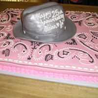Pink Bandana Anniversary Cake  This cake was done to match the table decorations for the Anniversary party. The bandana part of thecake is covered in fondant and...