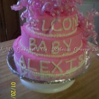 Hot Pink W/curly Ribbons This is a baby shower cake I did for my god daughter's shower. I had full reign with this one so I made it a yellow cake with hot pink...