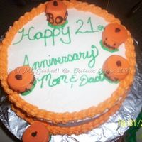 Halloween Anniversary Cake This is a 2 layer 8 inch French Vanilla cake with butter cream icing and marshmallow pumpkins (jumbo marshmallows coved in orange candy...
