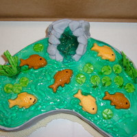 Pond Of My Parents  Made this for my Mother on Mothers Day. It is a rendition of her pond. Cake is lemon with lemon cream cheese icing. Fondant decorations and...