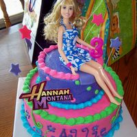 Allie's Hannah Montana Cake  This cake was for my daughter's third birthday. She told me she wanted pink and a Hannah Montana barbie on top. I wanted it to look...