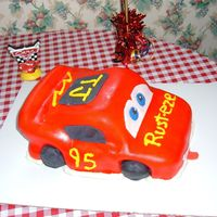 Lightning Mcqueen For Tj  My first time at cutting and shaping a cake. Also first try with fondant. I was going to add more details but ran out of time. My grandson...