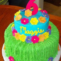 Maggie's Luau  This is a 10 in chocolate and 6 inch white cake. Iced in buttercream with fondant flowers. Thanks to lynsey for the grass skirt idea. It...