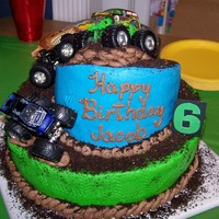 Jacob's Monster Jam Cake  My first Topsy Turvy!! I was so happy that it didn't fall to pieces!! It was for my son's 6th birthday. He helped with the design...