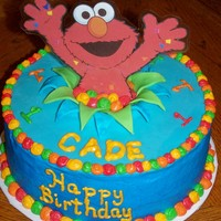 Cade's Elmo Cake  I made this for my nephew's first birthday. It is a 9 inch WASC with buttercream and fondant. I found elmo online then printed and...