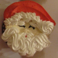 Fun With Santa Cupcakes! Santa Faces make for fun, high-in-demand treats! From-scratch moist delicious Red Velvet cupcakes!