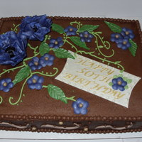 50Th Bd Cake Choc cake with PB mousse filling and choc bc. Flowers are fondant/gp.