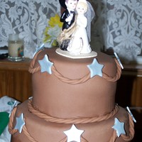 Western Style western wedding...chocolate fondant. I don't know who made this cake but the bride found it on a website and I just changed it up a...