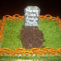 Graveyard   buttercream grass, pretzel fence,and graham cracker tombstone. enjoy