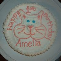 Kitty Cake  this is the first cake i ever did for someone outside the family. her daughter LOVES Kitties. It is a white cake with strawberry...