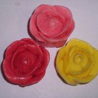 Starburstroses.jpg My first attempt at Starburst roses! I can't believe how easy they were. The first time I tried these with fondant they bombed, but...