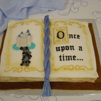 Fairytale Book This was made for my sister's bridal shower. WASC cake covered in fondant. Decorations are royal icing and fondant. Castle is white...
