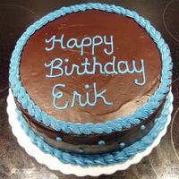 Birthday Cake This is my husband's birthday cake. He requested the double chocolate rum cake from the CMD, filled with chocolate mousse, and iced...