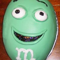 Ian's 17Th B'day Cake. M&m  As usual, his favorite all lemon cake, icing, fondant & curd filling. And of course his favorite colour ''green'&#039...