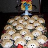Winnie The Pooh Cake & Hedgehog Cupcakes  Looking through old photos (pre-digital camera) I came across cakepictures to add. This one is Winnie the Pooh (bear pan) for the at home...