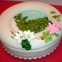 Christmas Day The cake was covered with fondant and the trees were painted with food coloring, and on top of the cake there is a cake ring covered with...