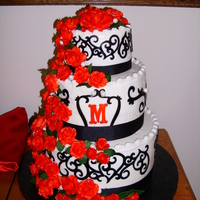 Red/black Theme Wedding Cake Roses are fondant, cake iced in BC, and I used the Cricut Cake for the black scroll work.