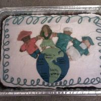 Around The World i made this cake for my dads class.he works at an international school.i made the world and people out of fondant