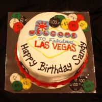 Las Vegas This was a fun cake to make, and I was pretty proud of it! It's a 2 layer white cake, with fresh banana filling. The poker chips are...