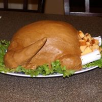 One Of Many!! Here is my shot at the turkey cake. I was pretty proud of myself for pulling it off. My family was impressed so it was worth it. Thanks for...