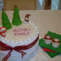 Xmas Cake Fruit cake iced with royal icing. Fondant snow man and RI trees..