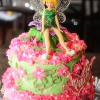 "Tinkerbell Cake 8"" and 6"" buttercream cake with strawberry and pineapple fillings. Design inspiriation from CC."
