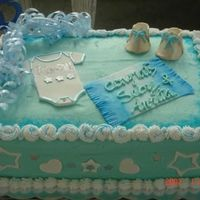Baby Shower Cake Wihite almond sour cream cake with raspberry choclate mousse and pineapple nu whipped cream filling..with buutercream frosting. cake is 11X...