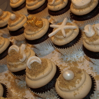 Beach Cupcakes  Beach themed cupcakes for a bridal shower. Sandals, beach ball, bikini, star fish made out of MMF, sand dollars were MMF from a candy mold...