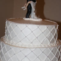 Simple Wedding Cake this was my first paid wedding cake order. i was happy it was a small one. i used the diamond pattern stamp and pearl boarder and edible...