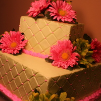 Happy Birthday... this is buttercream with the diamond pattern and silk flowers.