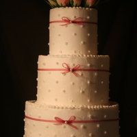 Simply Love Round cake buttercream with ribbon and silk flowers. this was a simple cake but one of my favorites.