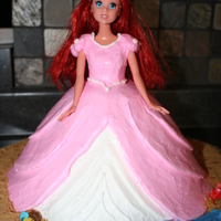 Ariel Cake this cake i did for my niece. it was my first barbie doll cake. she specifically wanted ariel in her dress. it was a little hard icing a...
