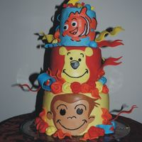 My Daughter's 2Nd Birthday Nemo, pooh, and curious george-I couldn't decide-and neither could my daughter. Cake is chocolate with orange SMBC and white cake with...