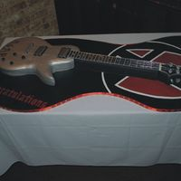 Guitar1.jpg guitar cake for graduation. hand cut and painted cake board. I painted his band's logo on the one end. everything is edible except the...