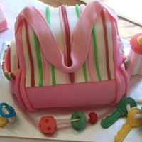 Marisa Baby Shower Diaper Bag 1st Diaper Bag Cake. BIG thanks to helipops for the help and inspiration!!! Accessories are all fondant, too.Mom to be is having a girl.......