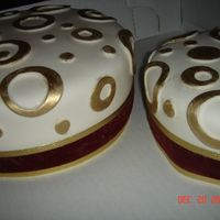 Anniversary Cakes These are some cakes that I made for an anniversary. They are covered in white fondant and accented with gold painted overlays and real...