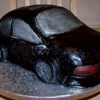 Black Bmw Vanilla sponge covered with sugarpaste, This is a replica of a real car, I made this cake by baking it in a round cake tin and carving it...
