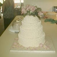 My 1St Wedding Cake Lemon cake with raspberry filling and buttercream filling. Used 6,8,10, and 12 pans