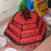 9Th_Birthday_Cake.jpg I made this cake for my Son's 9th Birthday. He had an Asian Party. I wrote in chinese....9 around the top layer, His name around the...
