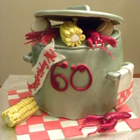 Ragin Cajun Birthday Cake   WASC with BC covered in fondant. Gumpaste lid, handles and crawfish. Fondant corn and potatoes.