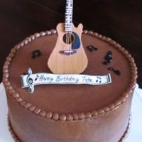 Tates Fondant Guitar My sons birthday cake. He is a music lover. The guitar is all fondant, and strings are thread.