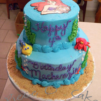 Little Mermaid Birthday Cake 2 tier Stacked white cake with butteceam icing. Flounder and Sebastian figures are my first attempts at fondant sculpting. Ariel on top is...