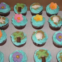 "Luau Cupcakes   These match my luau graduation cake. Brown sugar ""sand"" and fondant shells, palm trees, and flowers."