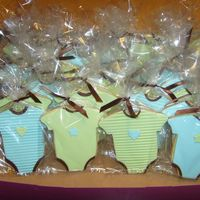 Onesie Cookies Onesie Cookies for a baby shower. Covered in fondant with fondant accents.