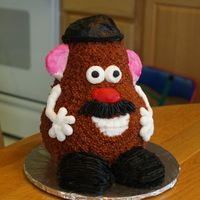 Mr. Potato Head This was a fun little cake I put together for an auction at my son's school. I had always wanted to try a Mr. Potato Head cake so it...
